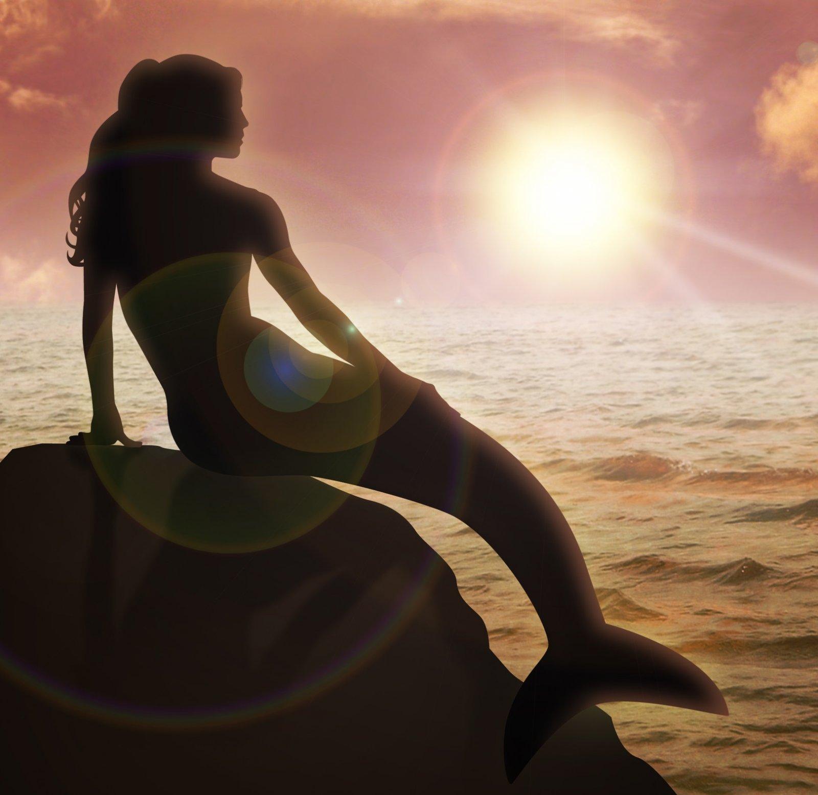 Mermaid-Silouhette-on-Rock-Ocean.jpg